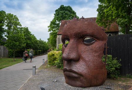 Canterbury, Kent, England - May 15 2017:  The face Mask or Bulkhead art created by Rick Kirby , British sculptor sitting outside Marlowe Theatre at the city of Canterbury, Kent UK. Editorial