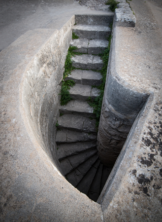 Stairs from an abandoned building leading to a vault Stock Photo