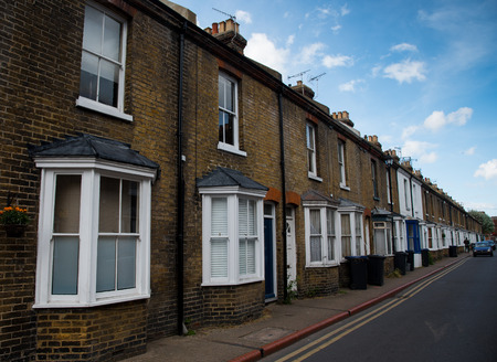 Traditional british houses with white windows at a neighborhood of  the city of Canterbury, Kent, United Kingdom