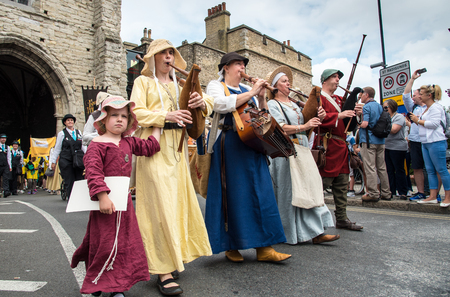 historical events: Canterbury, Kent, United Kingdom - 8 July 2017: People parading at the yearly traditional historical medieval parade at the city of Canterbury in Kent, United Kingdom.