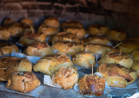 Traditional Cypriot easter cheese pastries cooked on a clay oven. The easter pastries are called flaounes and are made with various cheese.