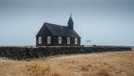 Famous picturesque black church of Budir at Snaefellsnes peninsula region in Iceland during a heavy snowy weather Фото со стока