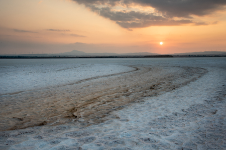 Beautiful colourful sunset over the empty dry salt lake of Larnaca in Cyprus