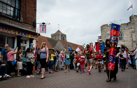 Canterbury, Kent, United Kingdom - 8 July 2017: People parading at the yearly traditional historical medieval parade at the city of Canterbury in Kent, United Kingdom.