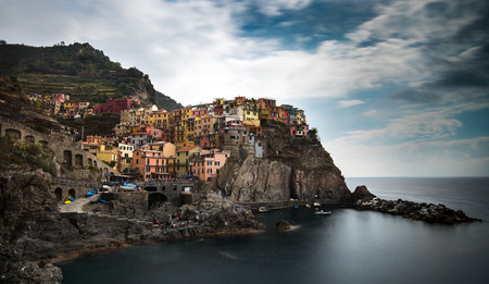 Picturesque and romantic village of Manarola with colourful houses and small beautiful port at CinqueTerre, Liguria, Italy Archivio Fotografico