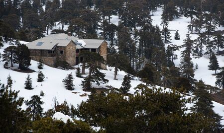 Idyllic abandoned mountain chalet at the forest of Troodos mountains in Cyprus during winter after a heavy snow.