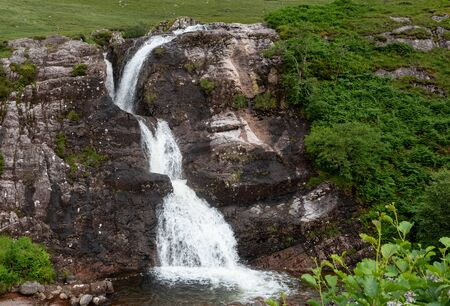 Water flowing in the beautiful waterfalls of the Meeting of the Three waters in the highlands of Scotland. Stok Fotoğraf