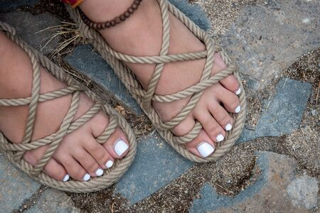 Beautiful and white polished toenails of a young teenage girl.