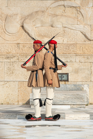 Athens Greece, 20 September 2019: Evzone Greek soldiers with traditional dressing and guns parading in front of the tomb of the unknown soldier in front of Athens parliament