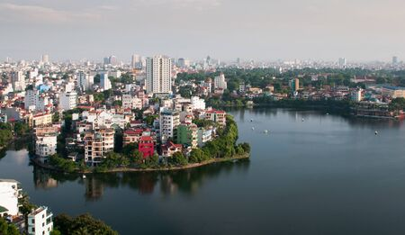 The skyline of Hanoi in  the capital city of Vietnam in Asia late in the evening