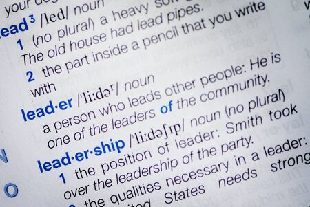 Close-up of the definition of the dictionary word leader and leadership