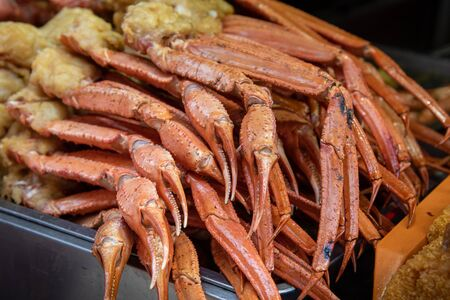 Delicious cooked healthy crabs fish ready to be eaten on an Asian food market Stock Photo