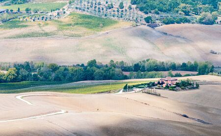Beautiful idyllic farmland with meadow filed at Tuscany area  near Montepulciano  touristic village, Italy, Europe Stock Photo