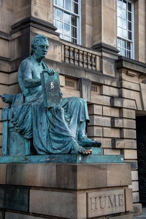 Edinburgh, Scotland, July 10 2019: The Famous David Hume statue on the Royal Mile famous street in Edinburg, Scotalnd, UK 報道画像