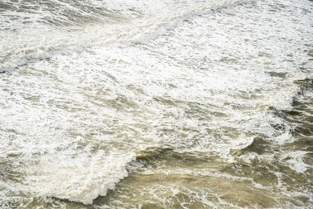 Seashore with wavy ocean and wind waves crashing on the rocks during sea storm Archivio Fotografico