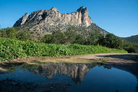 Famous Pentadaktylos rocky mountain peaks reflected on water in Kerynia town in Cyprus late in the evening. It is named as five finger mountain because of the five peaks. Foto de archivo