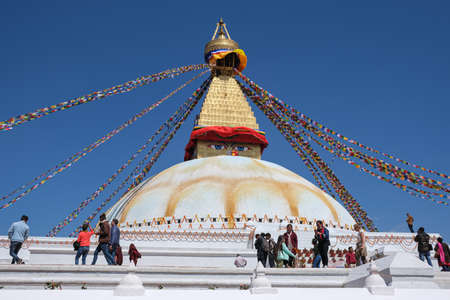 Kathmandu, Nepal - March 8 2020: Peope at the famous Boudha Stupa, one of the largest stupas in the world in the city of Kathmandu in Nepal
