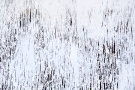 White textured background from a wooden surface. Abstract patterns.
