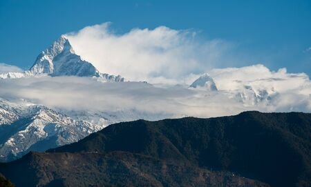 The famous Annapurna massif mountains in the Himalayas covered in clouds, snow and ice in north central Nepal Asia. Zdjęcie Seryjne