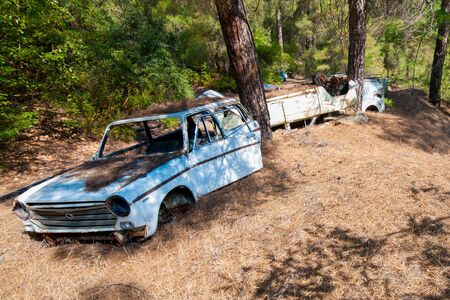 Wreck of a destroyed and abandoned car. Environmental pollution and need for recycling.
