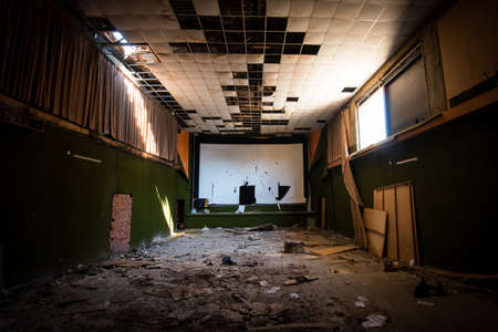 Abandoned and damaged interior of a stage theatre with bright light entering the building, Nicosia Cyprus Stock Photo