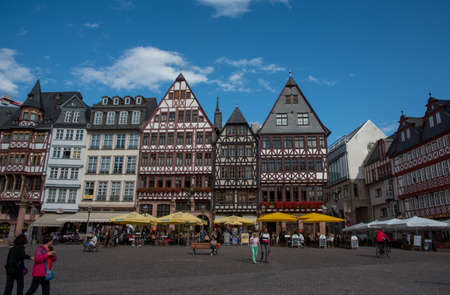 Romerberg square with tourist people walking at the city of Frankfurt in Germany