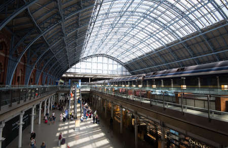 Kings Cross St Pancras Station with crowd of travellers. London, England Editorial