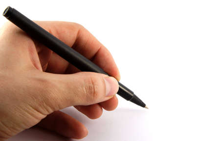 Black pen in a left hand on white background Stock Photo