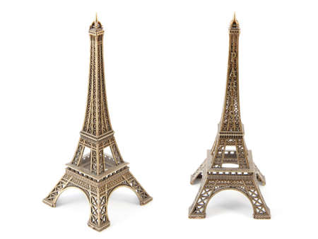 Small bronze copy of Eiffels Tower, isolated on white