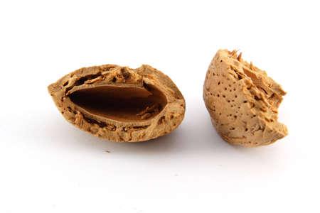 dado: Cracked almond shell on white background