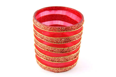 Glass candle holder with red pattern on white background