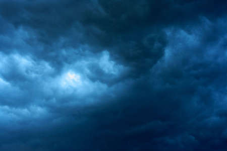 Dramatic dark stormy clouds, the storm is coming photo