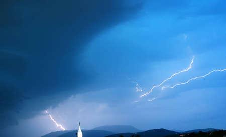Dark stormy sky with a lightning  photo