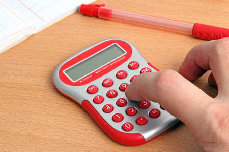 Red calculator and a hand