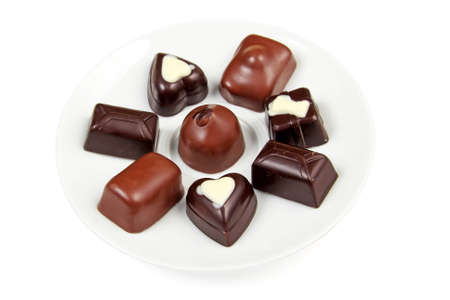 Assorted chocolates on a white saucer Stock Photo