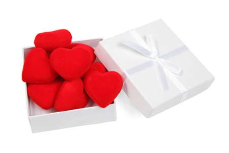 White gift box with red hearts inside on white background  Stock Photo