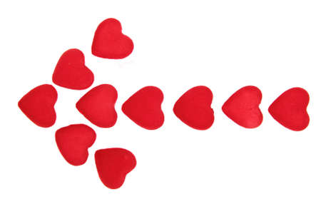 Arrow from the red hearts isolated on white  Stock Photo