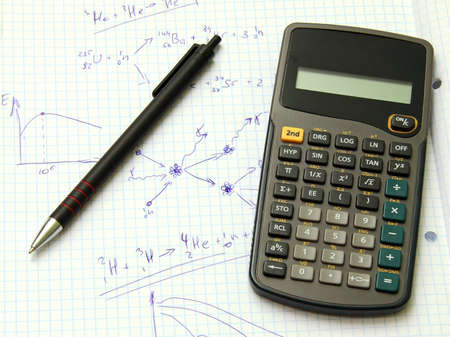 Scientific calculator and pan on notebook paper  photo