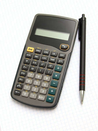 Scientific calculator and pan on notebook paper  Stock Photo
