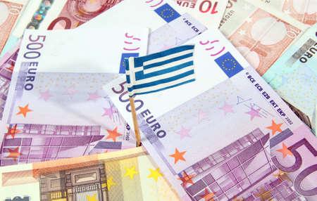 Euro banknotes and greeke flag
