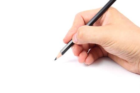 disegni a matita: Mano che tiene una matita nera su sfondo bianco Archivio Fotografico