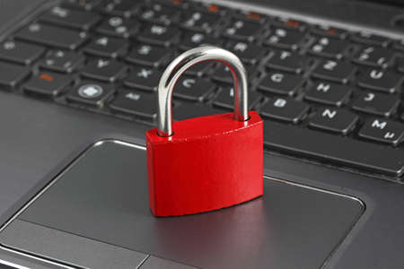 Padlock on black computer keyboard