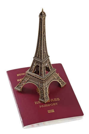 European Union passport and bronze copy of Eiffel Tower Stock Photo