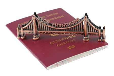 European Union passport and bronze copy of Golden Gate in San Francisco