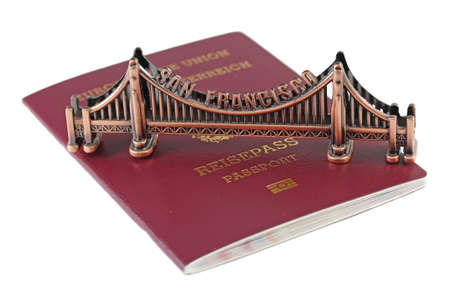 European Union passport and bronze copy of Golden Gate in San Francisco