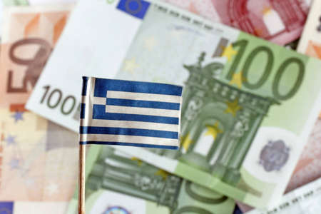greek currency: Euro banknotes and greek flag