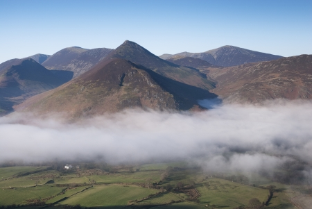 newlands: Fog Clearing over Newlands Valley, Cumbria, UK Stock Photo