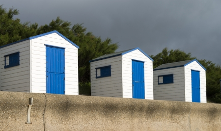 Blue and White Beach Huts at Southwold, Suffolk, UK.