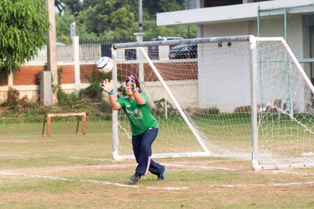 ayutthaya, thailand - 3 APR 2018 : Goalkeeper is receiving the ball at football matches In the chalk box closure activity of high school teachers in Bang Pa-in.