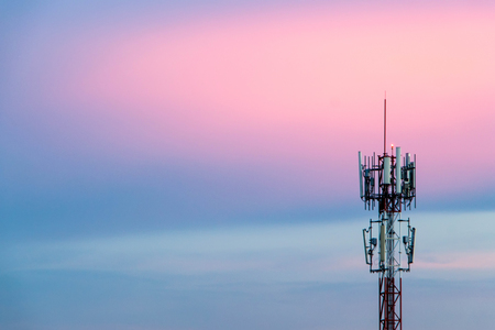 Cellular Signal Tower The background is sky in the evening, blue and pink. Banco de Imagens